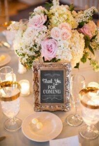 "Gold picture frame with chalk sign inside that reads ""thank you for coming""."
