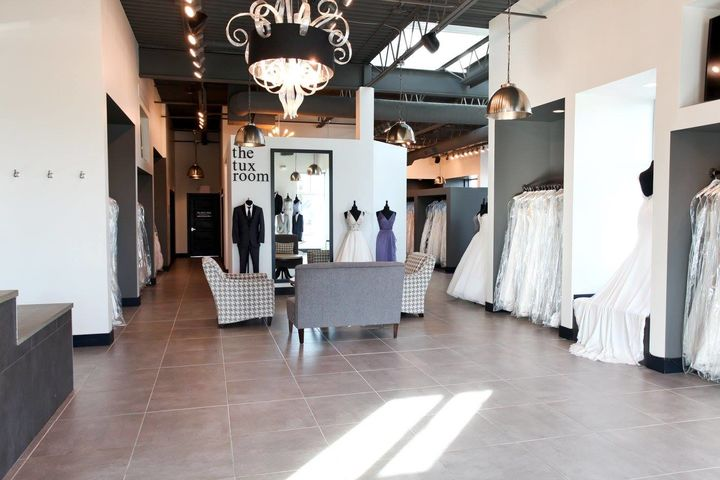 Showroom of bridal gowns and tuxes.